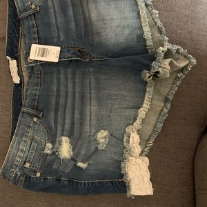 Distressed denim shirts with lace and bead detail